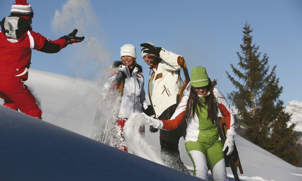 Tobogganing in the Dolomites with romantic extras